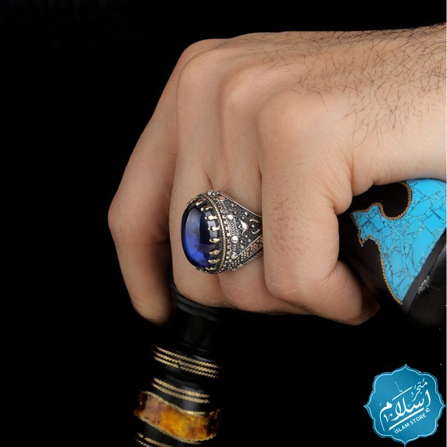 Silver ring with zircon stone blue color