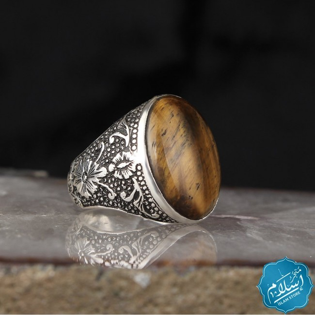 Silver ring with tiger eye stone brown color