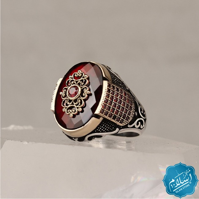 Silver ring with red zircon stone