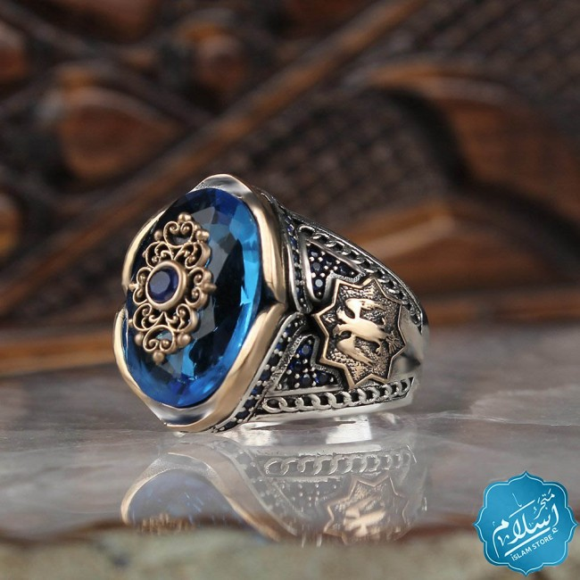 Mens silver ring decorated with aqua marin stone