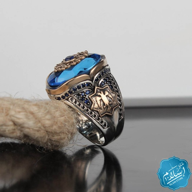 Men's silver ring decorated with aqua marin stone