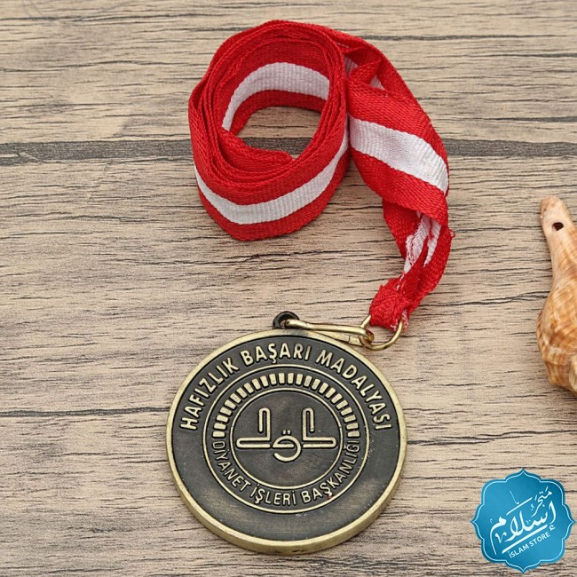 Success medal in a wooden box