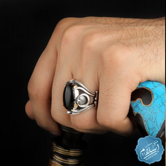 Silver ring with black onyx stone