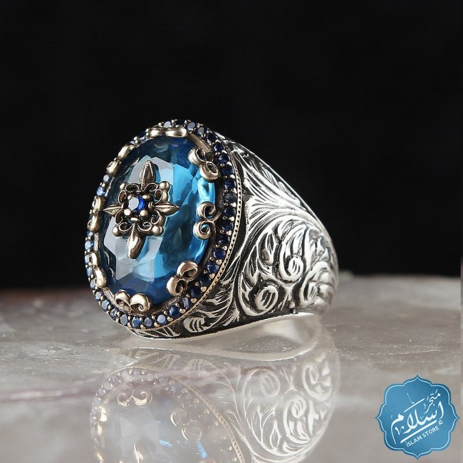 Silver ring with blue topaz stone