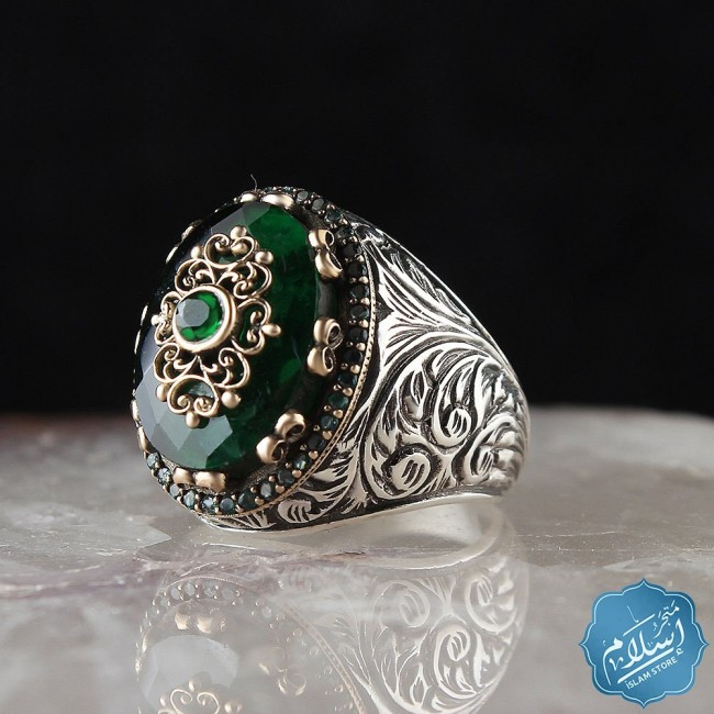 Engraved silver ring with green zircon stone