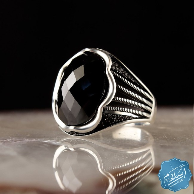 Silver ring with black zircon stone