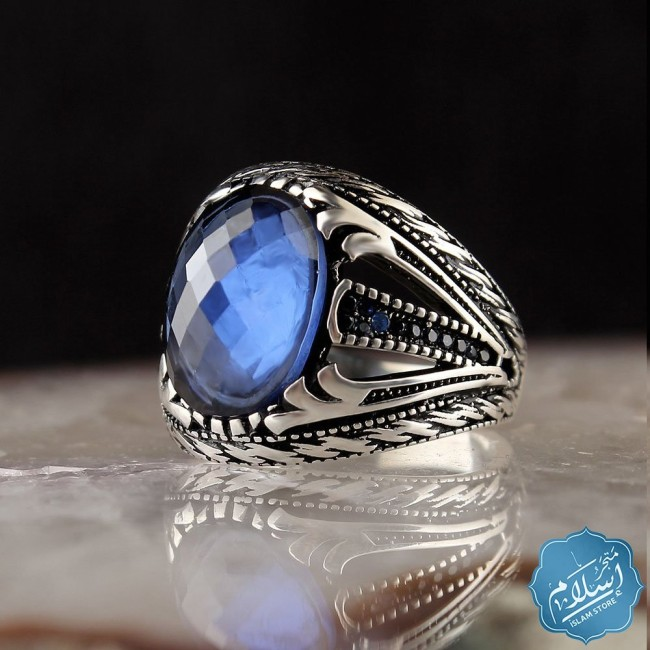 Silver ring with blue zircon stone
