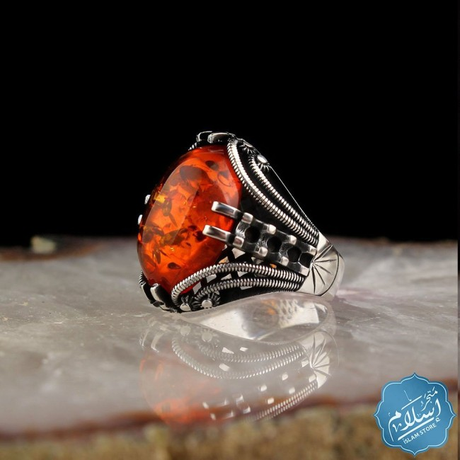 Silver ring with orange amber synthetic