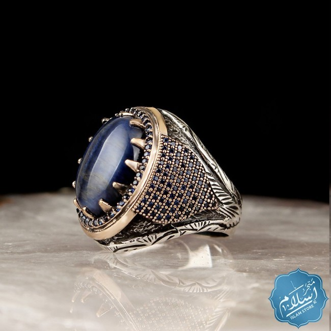 Silver ring with tiger eye stone blue color