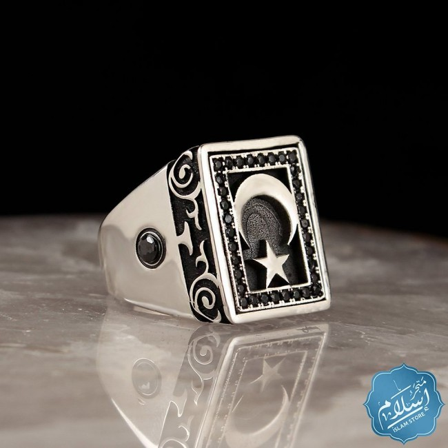 Silver ring with black zircon and moon star